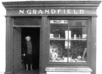 Nell outside her shope