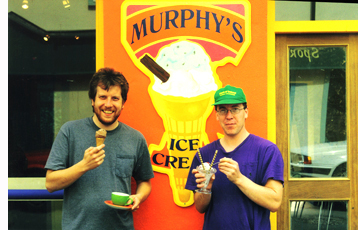 Sean and Kieran Murphy outside shop